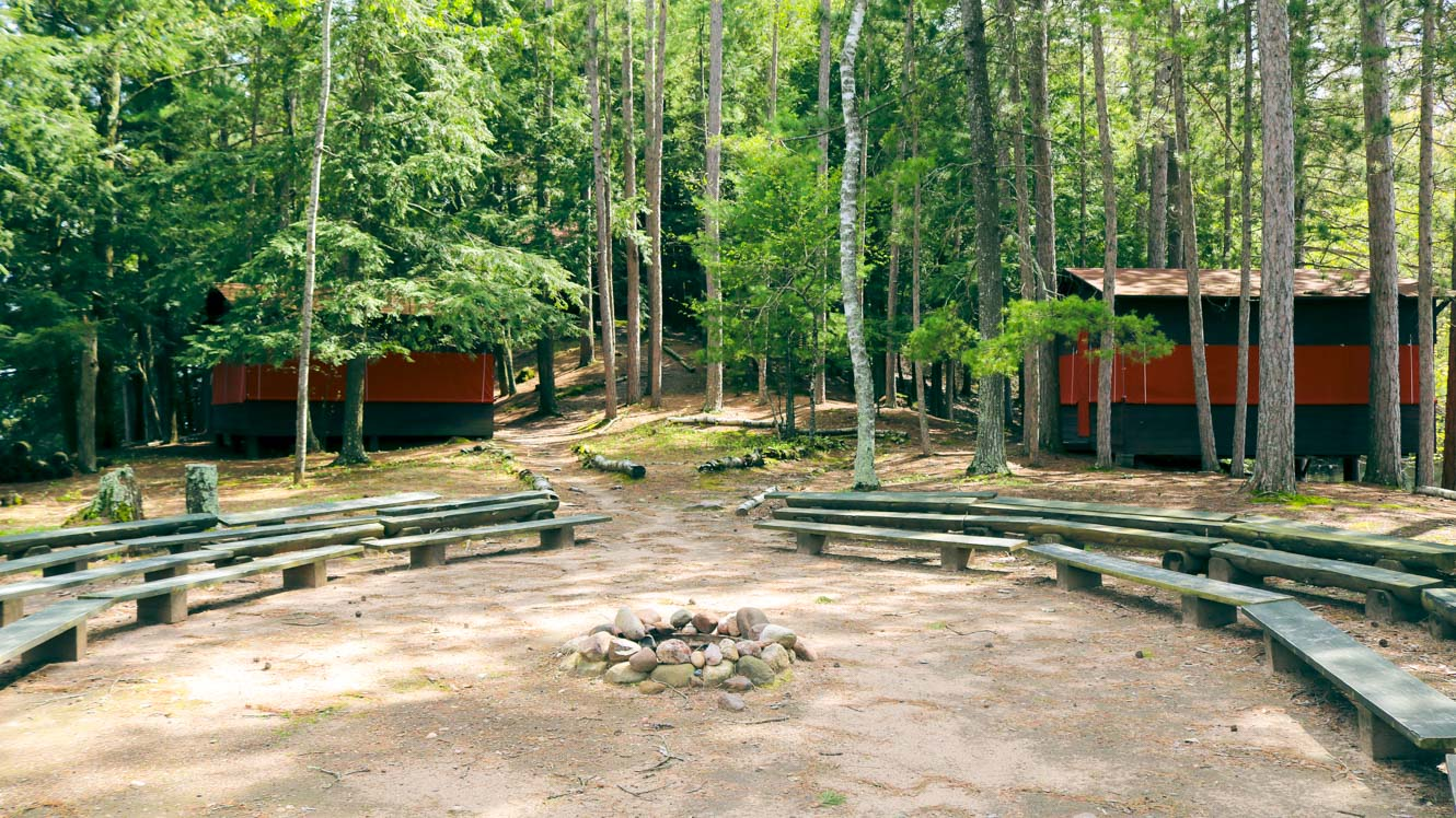 Clearwater Camp firepit with cabins visible behind