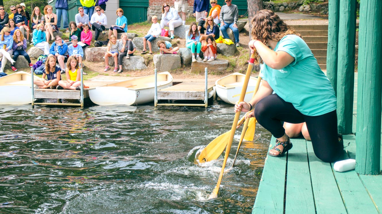 Counselors teach campers proper paddling