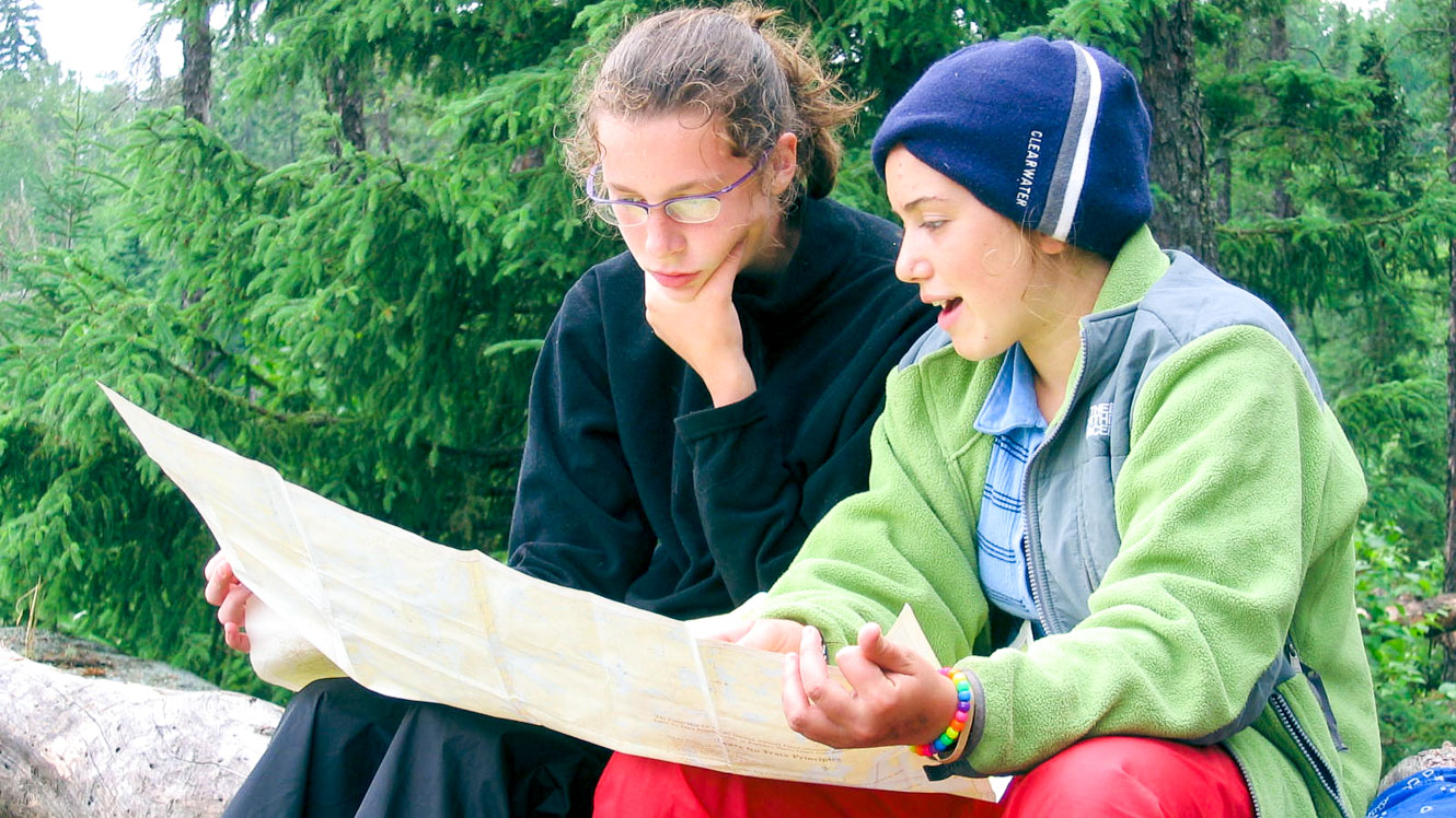 Two campers read a map