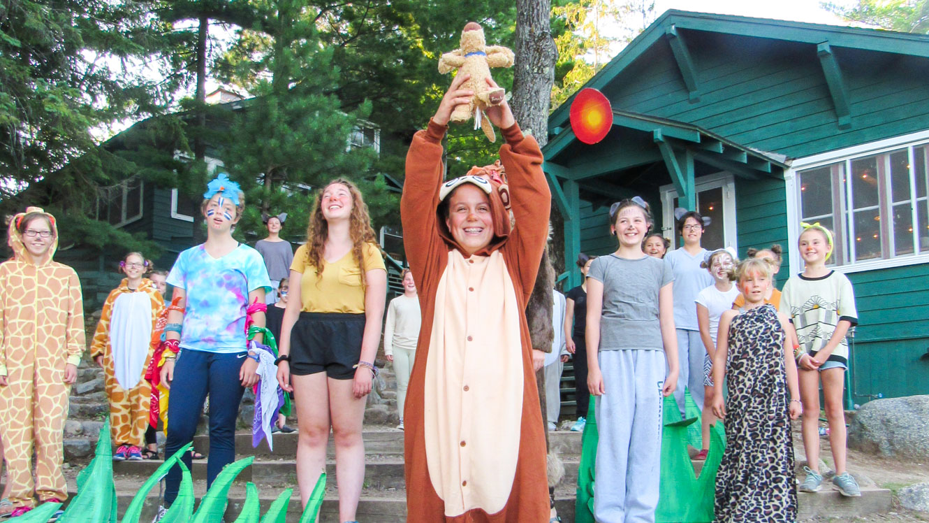 Camper lifts plush in performance of Lion King