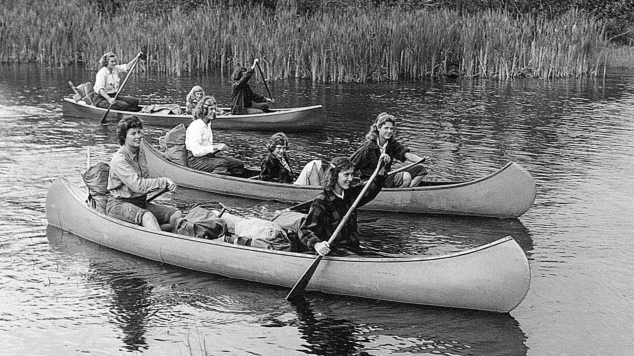 1948 photo of campers taking a canoe trip