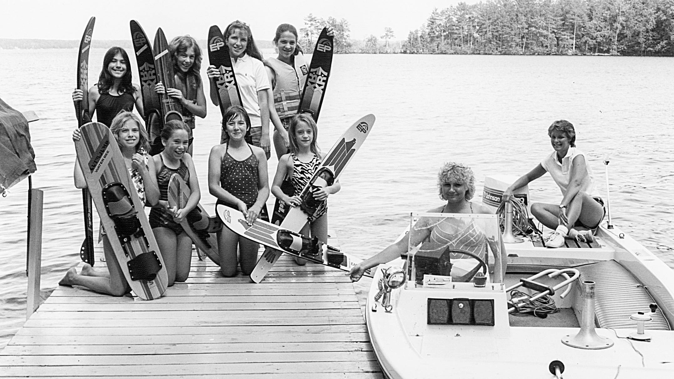 Black and white photo of camper preparing to waterski in 1983