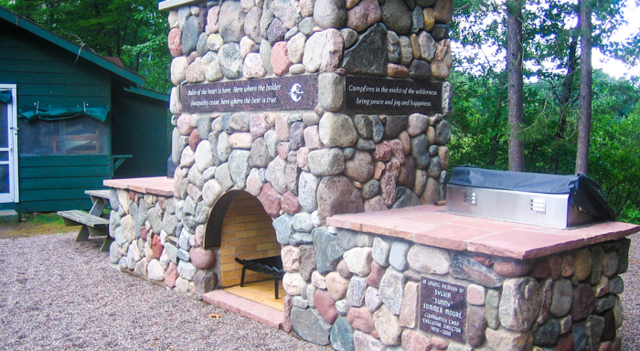 Clearwater camp outdoor stone fireplace with memorial plaques