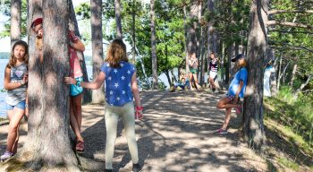 Campers hang out in trees on camp island