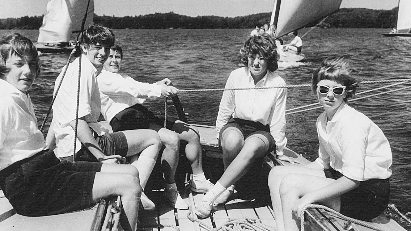 Black and white photo of 1961 campers in sailboat