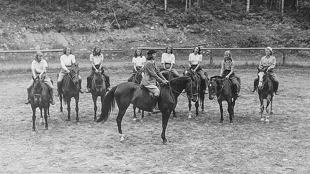1946 photo of campers riding horses