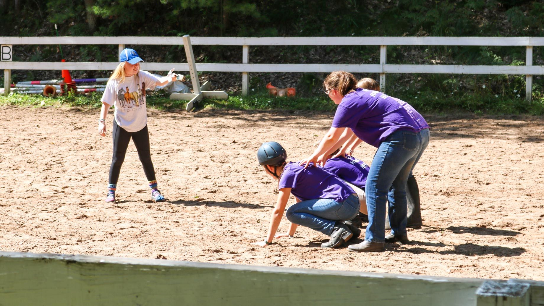 Campers participate in horseback riding exercise