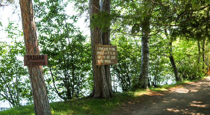 Tadjar Crossing and quote signs on trees along camp path