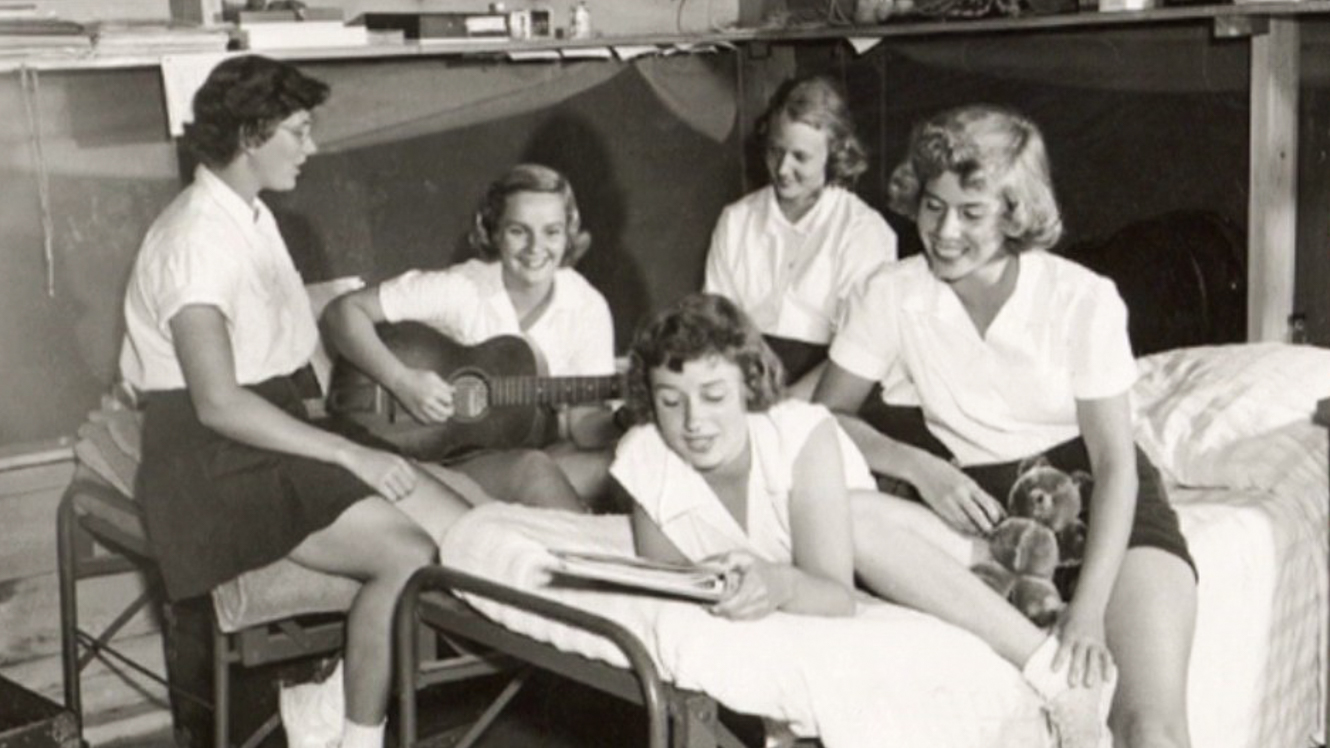 Black and white photo of campers playing music