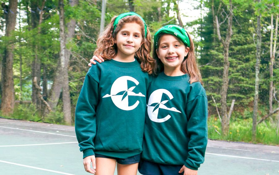 Two young campers wearing bandanas and Clearwater shirts