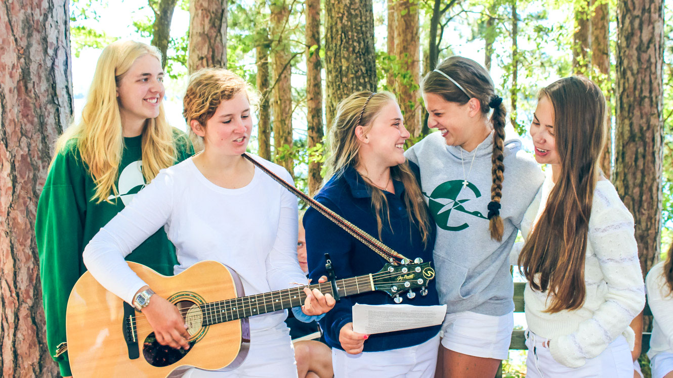 Campers perform with guitar during Clearwater Sunday Service