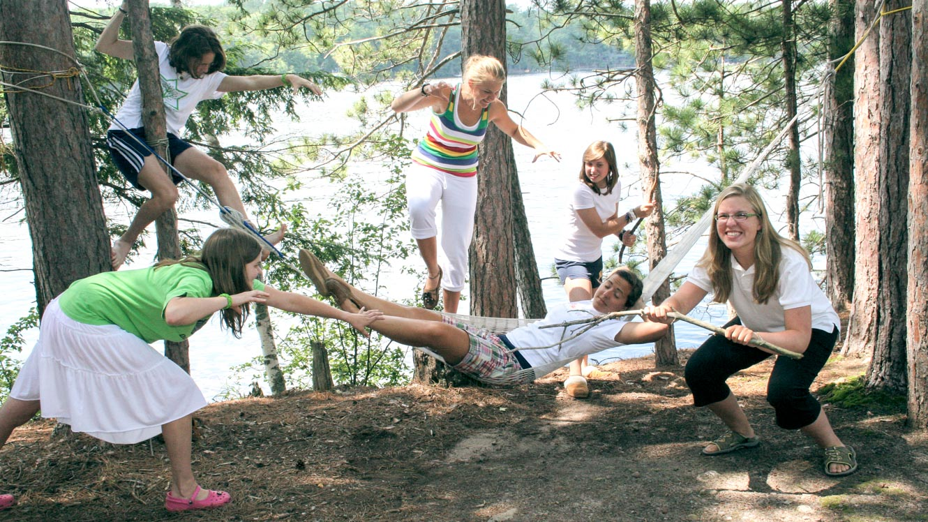 Campers pretend to attack sleeping girl in hammock