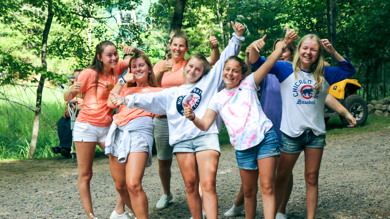 Camp staff and campers pose for excited photo