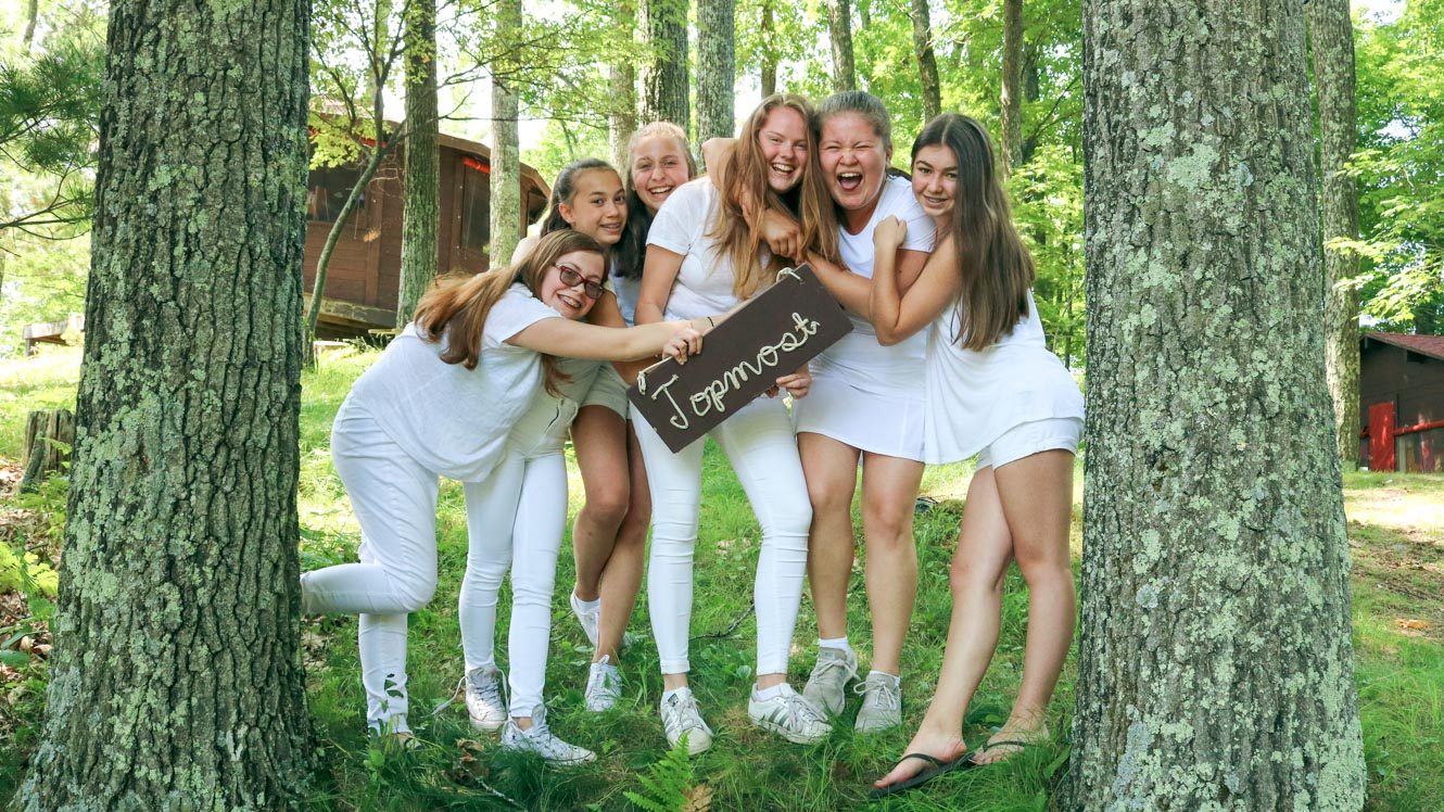 Girls from Topmost camp cabin pose casually